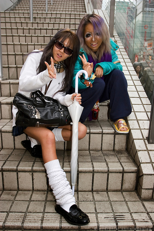 "Outside the 109 department store in Shibuya. Ajusa (left) is wearing her school uniform and Megumi (right) is casualy dressed except her make-up that is in the style of ""Ganguro Gal"""
