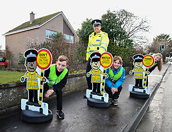 Community beat Sergeant Neil Johnston with 11 year olds Jack Wilson (front), Liam Black (middle) and Kayden Fettes (rear) with the 'pop up' school kids who will be positioned outside schools across the country as part of a new Police Scotland school road safety initiative.<br /> <br /> © Dave Johnston/ EEm