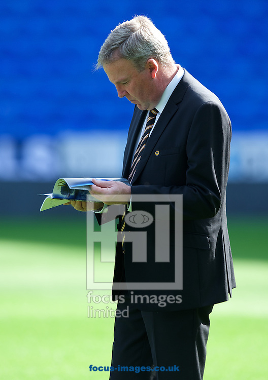 Manager Kenny Jackett of Wolverhampton Wanderers looks at the match day program before the Sky Bet Championship match at the Madejski Stadium, Reading<br /> Picture by Alan Stanford/Focus Images Ltd +44 7915 056117<br /> 28/09/2014