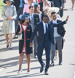 © Licensed to London News Pictures. 19/05/2018. London, UK. Actor IDRIS ELBA and partner. Guests arrive at The wedding of Prince Harry, The Duke of Sussex to Meghan Markle, The Duchess of Sussex, at St George's Chapel in Windsor. Photo credit: Ben Cawthra/LNP