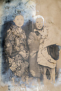 young mother holding baby casual posing with friend Japan ca 1930s