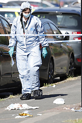 © Licensed to London News Pictures. 11/06/2018. London, UK. A police forensics officer is seen where a 17 year old was critically injured in a stabbing in Harrow last night.Police are also dealing with a stabbing incident in nearby Northolt where a 20 year old was injured. Photo credit: Peter Macdiarmid/LNP