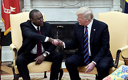 U.S. President Donald Trump checks hands with Kenya's President Uhuru Kenyatta during a bilateral meeting in the Oval Office of the White House August 27, 2018 in Washington, DC. . Photo by Olivier Douliery/ Abaca Press