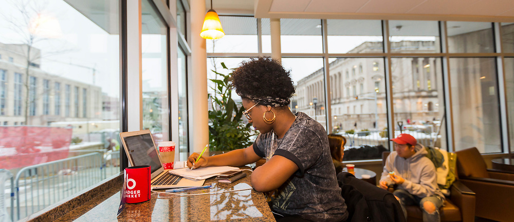 Students waste no time claiming their study spots in the newly rennovated Peets Coffee in Memorial Union in 2016.