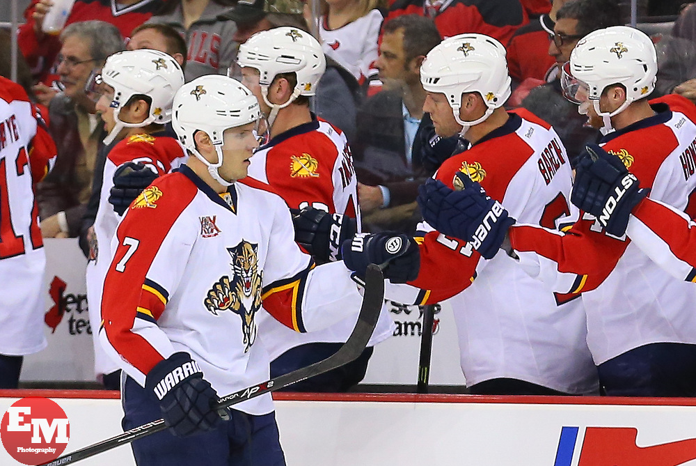 Mar 31, 2014; Newark, NJ, USA; Florida Panthers defenseman Dmitry Kulikov (7) is congratulated after his goal during the first period at Prudential Center.