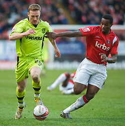 LONDON, ENGLAND - Saturday, January 30, 2010: Charlton Athletic's Jose Semedo and Tranmere Rovers' Tranmere's Craig Curran in action during the Football League One match at the Valley. (Photo by Gareth Davies/Propaganda)