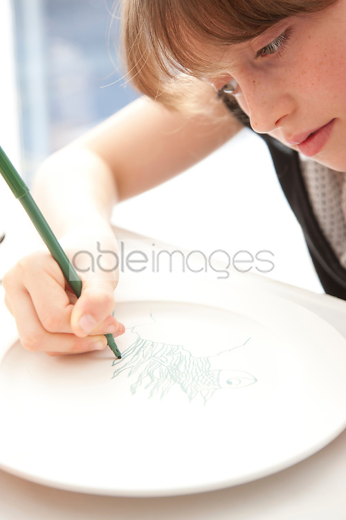 Girl Drawing on Ceramic Plate