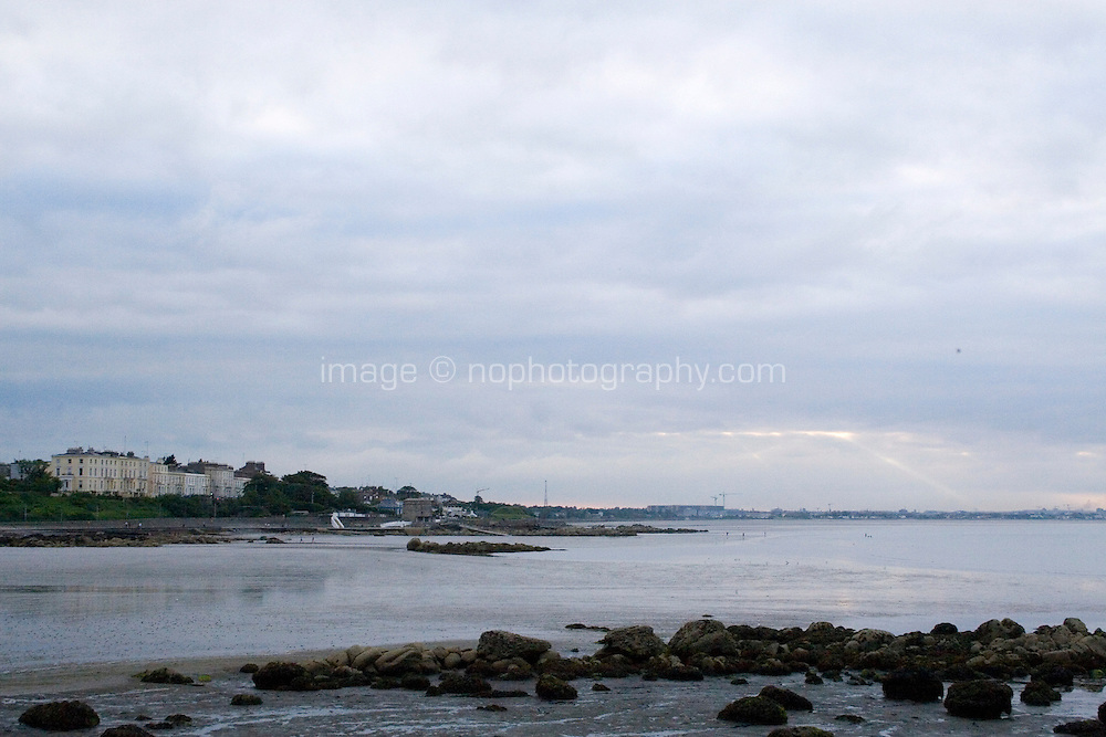 Evening view of Seapoint with martello tower in Dublin Ireland