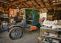 Old truck in garage over route 66 in Arizona.