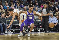 December 29, 2017 - Sacramento, CA, USA - The Sacramento Kings' Frank Mason III (10) steals the ball from the Phoenix Suns' Devin Booker on Friday, Dec. 29, 2017, at the Golden 1 Center in Sacramento, Calif. (Credit Image: © Hector Amezcua/TNS via ZUMA Wire)