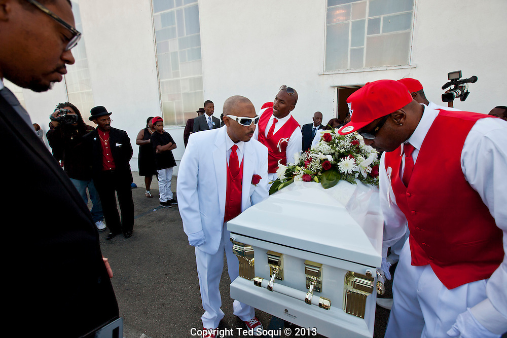 Pall bearers carry Kevin's casket.<br /> Funeral services for Kevin &quot;Flipside&quot; White at Macedonia Church in Watts.<br /> White was shot dead in what is believed to be an unprovoked attack during a gang conflict at Watts' Nickerson Gardens and Jordan Downs housing projects.<br /> Flipside, 44, was a founding member of Watts' first major label hip hop act, O.F.T.B. (Operation From The Bottom).