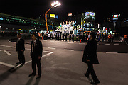 Secret service men keep guard as Japanese Prime Minister, Shinzo Abe electioneering in Urawa, Saitama, Japan Friday December 12th 2014