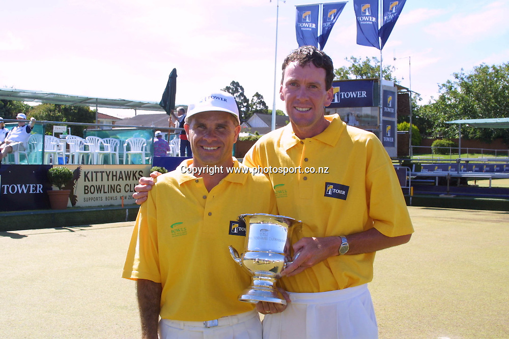 Pairs champions David Clark and Mike Galloway with their trophy after winning the doubles at the Mens Open New Zealand National Lawn Bowls Championships, 2001. Photo: Dean Treml/PHOTOSPORT *** Local Caption ***