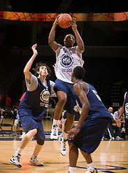 PF Richard Howell (Marietta, GA / Wheeler) leaps past C Carlos Lopez (Henderson, NV / Findlay College Prep).  The NBA Player's Association held their annual Top 100 basketball camp at the John Paul Jones Arena on the Grounds of the University of Virginia in Charlottesville, VA on June 19, 2008
