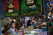 Posters of Iraqi Shi'a Mulsim imams adorn a food cart outside the Khadamiyah Shrine September 04, 2010 in Baghdad, Iraq. An intense power struggle between Iraq's Shia political leaders and parties is one of the main obstacles to the formation of a new government since the inconclusive March 2010 poll, according to senior Iraqi officials involved in ongoing negotiations. Credit: Scott Nelson for the Wall Street Journal.Slug: Iraq - Shia divisions.