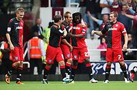 Fotball<br /> England<br /> Foto: Colorsport/Digitalsport<br /> NORWAY ONLY<br /> <br /> Football<br /> npower Championship<br /> West Ham United vs Portsmouth<br /> at Upton Park<br /> Portsmouth's Goalscorer Benjani celebrates scoring with fellow scorer Luke Varney<br /> 10/09/2011<br /> <br /> Erik Huseklepp (L)