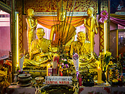 "14 FEBRUARY 2018 - BANG KRUAI, NONTHABURI, THAILAND: Statues of the Buddha in the rebirthing hall at Wat Ta Khien, about 45 minutes from Bangkok in Nonthaburi province. The temple is famous for the ""floating market"" on the canal that runs past the temple and for the ""resurrection ceremonies"" conducted by monks at the temple. People lie in a coffin and ritualistically die before being reborn. Adherents believe it will improve their karma and help make up for past sins.         PHOTO BY JACK KURTZ"