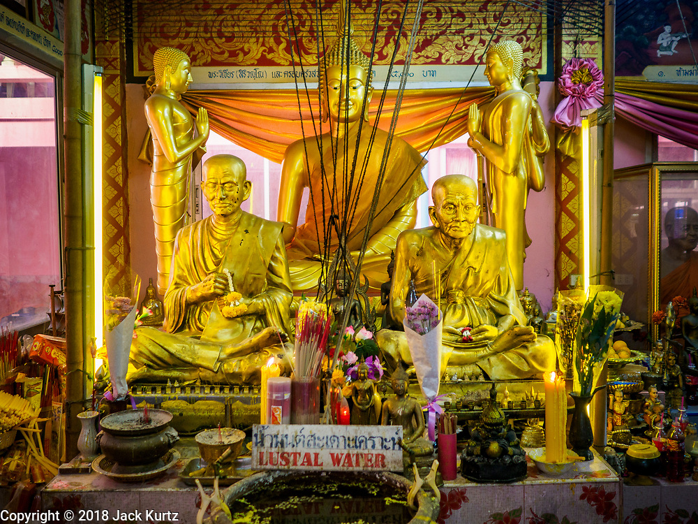 """14 FEBRUARY 2018 - BANG KRUAI, NONTHABURI, THAILAND: Statues of the Buddha in the rebirthing hall at Wat Ta Khien, about 45 minutes from Bangkok in Nonthaburi province. The temple is famous for the """"floating market"""" on the canal that runs past the temple and for the """"resurrection ceremonies"""" conducted by monks at the temple. People lie in a coffin and ritualistically die before being reborn. Adherents believe it will improve their karma and help make up for past sins.         PHOTO BY JACK KURTZ"""