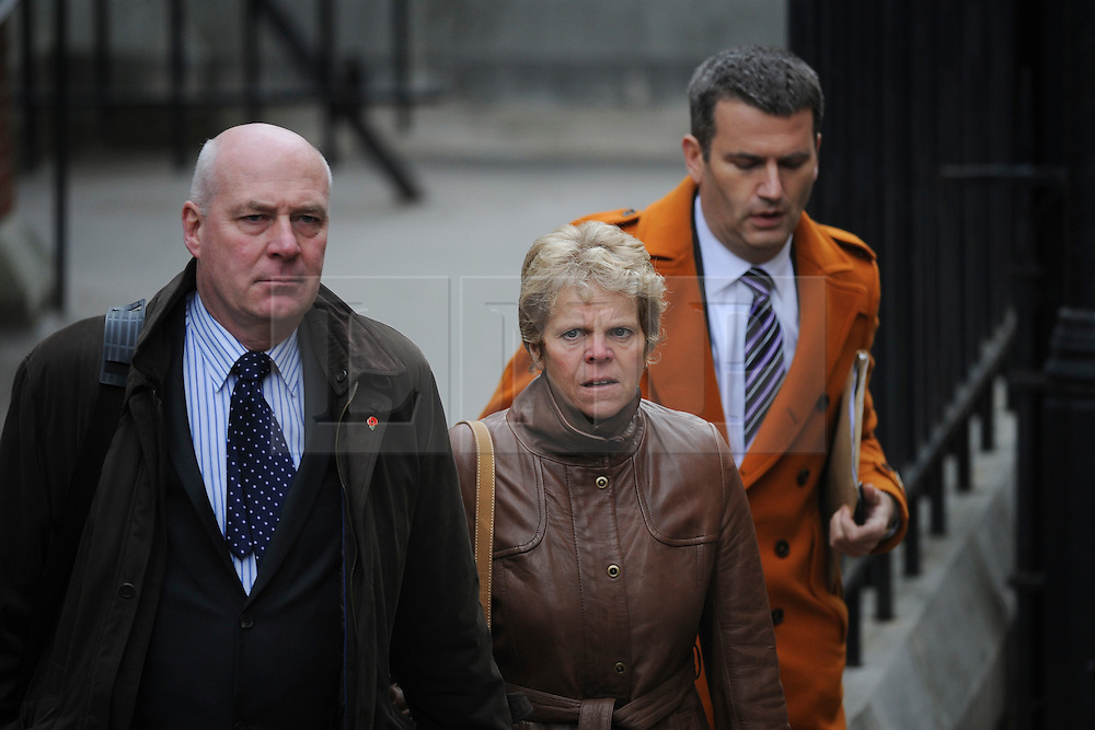 © London News Pictures. File picture dated 21/11/2011. London, UK.  The parents of the murdered schoolgirl Milly Dowler, L to R Sally Dowler, Milly's mother,  and Robert Dowler, Milly's Father  with Mark Lewis, The Dowlers solicitor (right)  arriving at The Royal Courts of Justice today (21/11/2011) to give evidence at the Leveson Inquiry into press standards. Milly Dowler's Killer,  Levis Belfield, has confessed further details of how he tortured, raped and killed the teenager.. Photo credit : Ben Cawthra/LNP