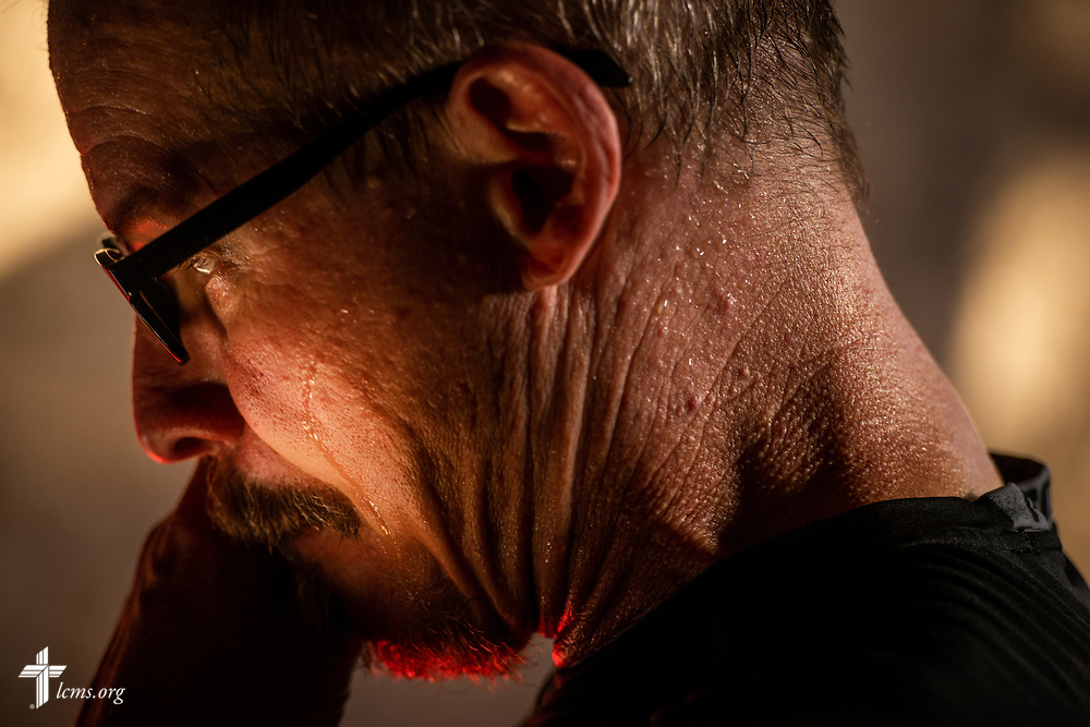 The Rev. Gary Schulte, area director for West and Central Africa, wipes sweat from his face as he works in the pharmacy on the second day of the LCMS Mercy Medical Team on Tuesday, May 8, 2018, in the Yardu village outside Koidu, Sierra Leone, West Africa. LCMS Communications/Erik M. Lunsford
