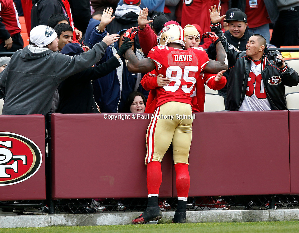 San Francisco 49ers tight end Vernon Davis (85) gets congratulated by fans after catching a third quarter touchdown pass that gives the Niners a 17-3 lead during the NFL week 17 football game against the Arizona Cardinals on Sunday, January 2, 2011 in San Francisco, California. The 49ers won the game 38-7. (©Paul Anthony Spinelli)