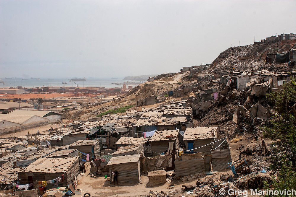 CAIXITO, ANGOLA OCT 1, 2007:  Angolan residents of the Boavista shanty town built on a garbage dump of the capital, Luanda Oct 1, 2007. Fueled by massive oil wealth, Luanda has some of the most expensive real estate in the world.    Photo Greg Marinovich