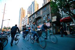 CHINA SHANGHAI NOV01 - Cyclists on the road in downtown Shanghai.. . . jre/Photo by Jiri Rezac. . © Jiri Rezac 2001. . Contact: +44 (0) 7050 110 417. Mobile:  +44 (0) 7801 337 683. Office:  +44 (0) 20 8968 9635. . Email:   jiri@jirirezac.com. Web:     www.jirirezac.com
