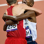 Galen Rupp of the United States, left, hugged winner and gold medalist Mohamed Farah of Great Britain, right, at the end of the men's 10,000m final at Olympic Stadium during the 2012 Summer Olympic Games in London, England, Saturday, August 4, 2012. Rupp won the silver medal in the event. (David Eulitt/Kansas City Star/MCT)