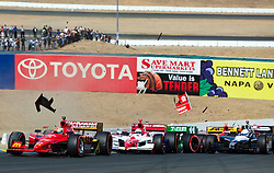 Tony Kanaan (11) collides into the back of Scott Dixon (9) on the first lap at turn 2 in the 2009 Sonoma Grand Prix IndyCar race was held at Infineon Raceway in Sonoma, California on August 23, 2009.  The wreck disabled Dixon's car and caused damage to several others in the field.