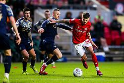 Jamie Paterson of Bristol City is challenged by Jordan Williams of Barnsley - Rogan/JMP - 18/01/2020 - Ashton Gate Stadium - Bristol, England - Bristol City v Barnsley - Sky Bet Championship.