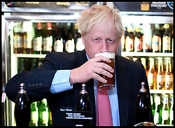 July 10, 2019, London, United Kingdom: BORIS JOHNSON with the owner of Wetherspoons Tim Martin (not shown) at one of his pubs in central London, during his campaign in his bid to become the new leader of the Conservative Party and Britain's new Prime Minister. (Credit Image: © Andrew Parsons/i-Images via ZUMA Press)