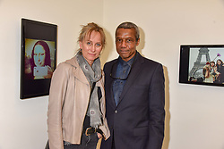 Hugh Quarshie and Annika Sundstrom at a preview of the 'From Selfie To Self-Expression' exhibition at The Saatchi Gallery, Duke Of York's HQ, King's Road, London, England. 30 March 2017.