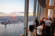 People view the sunrise at the newly-built One World Observatory<br />