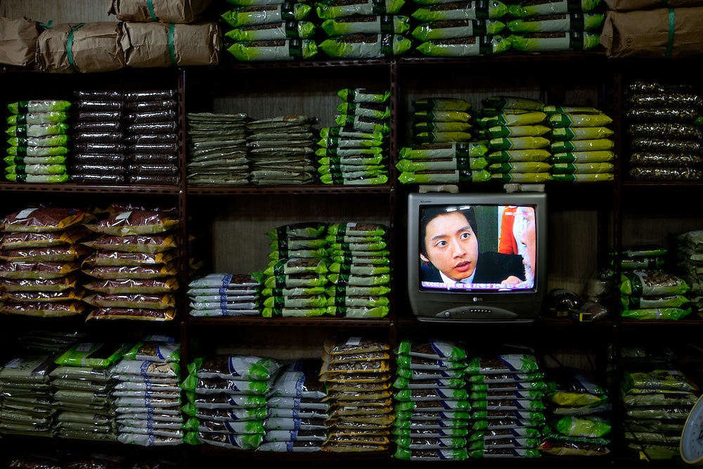Daegu/South Korea, Republic Korea, KOR, 16.10.2009: Television at a store at the herbs market for traditional medicine in Daegu.