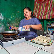 CAPTION: Before Typhoon Ondoy, Hilda Ochoa had a successful small business selling spring rolls. Tragically, when the floods came, they washed away all of her assets. She tried to re-start her business, but with little equipment, no insurance and limited savings, she wasn't able to realise its full potential once more. LOCATION: Ampalaya Street, Barangay Tumana, Marikina City, Philippines. INDIVIDUAL(S) PHOTOGRAPHED: Hilda Ochoa.