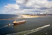 Nederland, Noord-Holland, IJmuiden, 16-04-2008; zicht op het terrein van Corus en de ingang van het Noordzee kanaal; het schip in de havenmonding wordt begeleid door twee sleepboten, rechts de loodsboot; loods, zeesleper (Corus: voorheen Hoogovens gefuseerd met British Steel)..luchtfoto (toeslag); aerial photo (additional fee required); .foto Siebe Swart / photo Siebe Swart