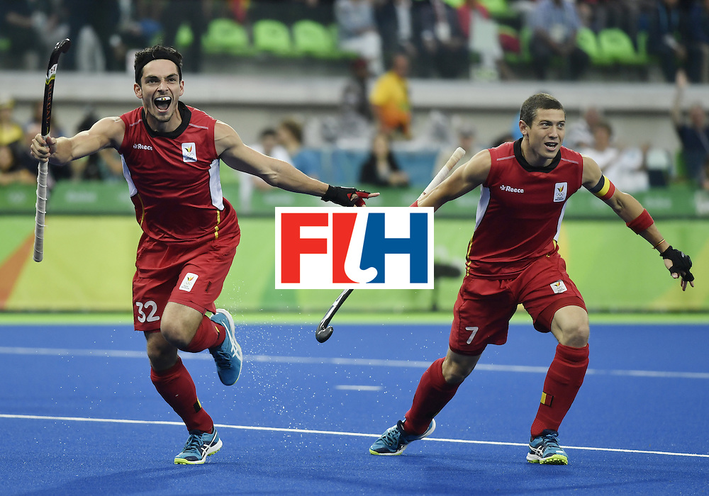 Belgium's Tanguy Cosyns (L) celebrates with Belgium's John John Dohmen after scoring the opening goal during the men's Gold medal field hockey Belgium vs Argentina match of the Rio 2016 Olympics Games at the Olympic Hockey Centre in Rio de Janeiro on August 18, 2016. / AFP / PHILIPPE LOPEZ        (Photo credit should read PHILIPPE LOPEZ/AFP/Getty Images)