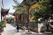 Tourists visit the Jade Buddha Temple, Shanghai, China