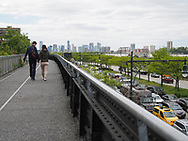 The Highline park overlooking the Westside highway and the Jersey City skyline in the background.