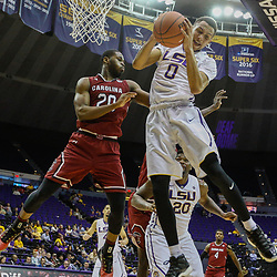 Feb 1, 2017; Baton Rouge, LA, USA; LSU Tigers guard Brandon Sampson (0) rebounds over South Carolina Gamecocks guard Justin McKie (20) during the second half of a game at the Pete Maravich Assembly Center. South Carolina defeated LSU 88-63. Mandatory Credit: Derick E. Hingle-USA TODAY Sports