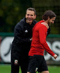 CARDIFF, WALES - Sunday, October 14, 2018: Wales' assistant coach Albert Stuivenberg and Joe Allen during a training session at the Vale Resort ahead of the UEFA Nations League Group Stage League B Group 4 match between Republic of Ireland and Wales. (Pic by David Rawcliffe/Propaganda)