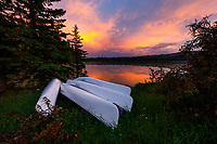 The beautiful glow of sunset over a raft of canoes on the shore of Westover Lake in the foothills west of Calgary.<br /> <br /> &copy;2017, Sean Phillips<br /> http://www.RiverwoodPhotography.com