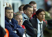 30/10/2004<br />FA Barclays Premiership - Fulham v Tottenham Hotspur - Craven Cottage, London<br />Tottenham Hotspur's dejected manager Jacques Santini  (l) stands in the dugout to watch his team lose 2-0, as Fulham manager Chris Coleman (r) watches from the home dugout.<br />Photo:Jed Leicester/Back Page Images