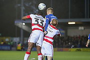 AFC Wimbledon striker Joe Pigott (39) battles for possession with Doncaster Rovers defender Donervon Daniels (33) during the EFL Sky Bet League 1 match between AFC Wimbledon and Doncaster Rovers at the Cherry Red Records Stadium, Kingston, England on 14 December 2019.