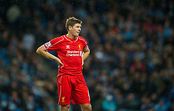 MANCHESTER, ENGLAND - Monday, August 25, 2014: Liverpool's captain Steven Gerrard looks dejected as his side lose 3-1 to Manchester City during the Premier League match at the City of Manchester Stadium. (Pic by Chris Brunskill/Propaganda)