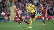 Billy Clarke (Bradford) runs with the ball, leaving Nick Beasant (Chesham) behind him during the The FA Cup match between Bradford City and Chesham FC at the Coral Windows Stadium, Bradford, England on 6 December 2015. Photo by Mark P Doherty.