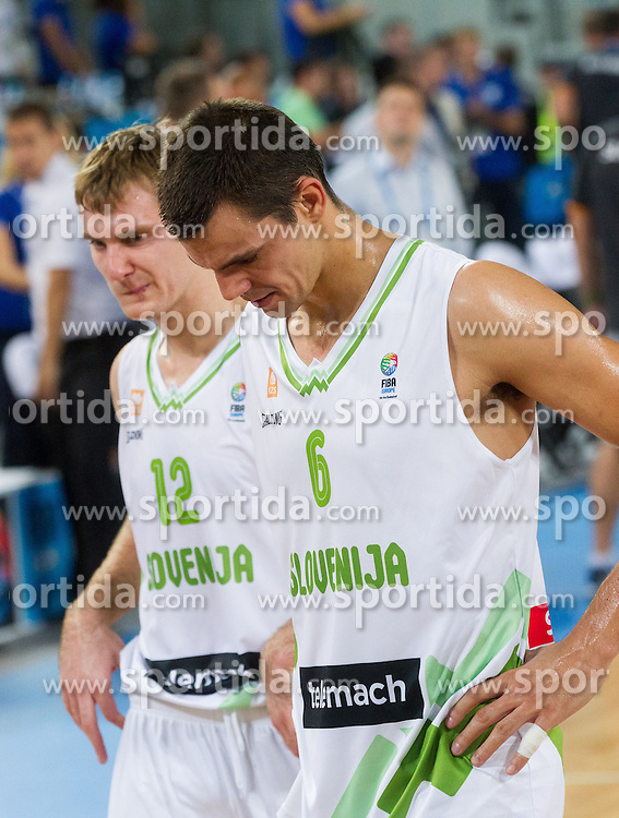 Zoran Dragic of Slovenia and Jure Balazic of Slovenia after the basketball match between National teams of Slovenia and France in Quarterfinals at Day 15 of Eurobasket 2013 on September 18, 2013 in Arena Stozice, Ljubljana, Slovenia. (Photo by Vid Ponikvar / Sportida.com)