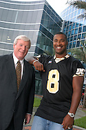 University of Central Florida head football coach George O'Leary, left, with alumni and former NFL quarterback Daunte Culpepper on the UCF campus in Orlando, Florida.