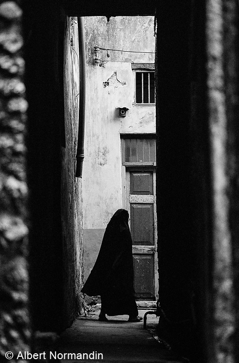 Woman in alley, Island of Lamu, Kenya, July, 2002