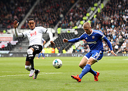 Jake Bidwell of Brentford crosses past Thomas Ince of Derby County - Mandatory byline: Robbie Stephenson/JMP - 07966 386802 - 03/10/2015 - FOOTBALL - iPro Stadium - Derby, England - Derby County v Brentford - Sky Bet Championship